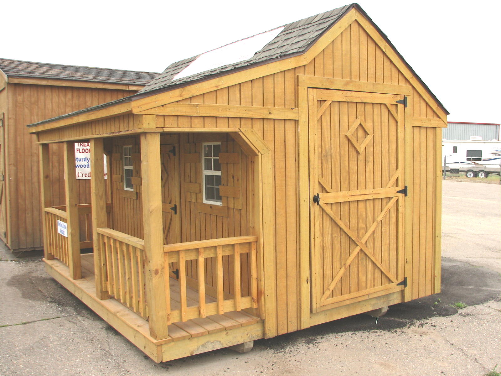 Mini cottage by better built portable storage buildings for Building a storage shed